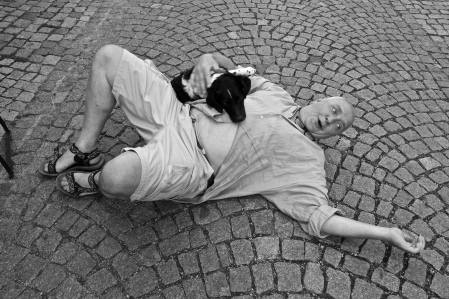 He wanted his portrait taken of him on the ground; so here it is -- Cesky Krumlov, Czech Republic